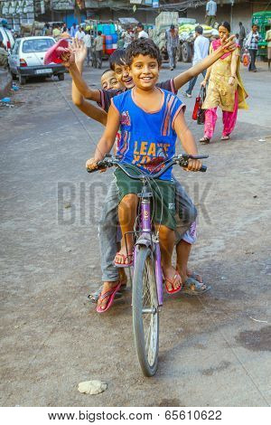 Children Sitting On A Bike Early Morning