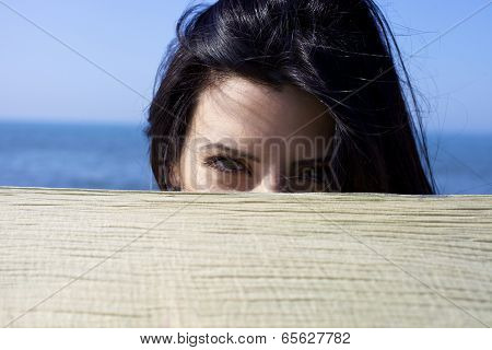 Woman Hiding Behind Veil Playing Showing Green Eyes