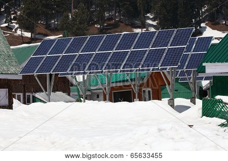 Solarcells On A Winter With Snow Mountain
