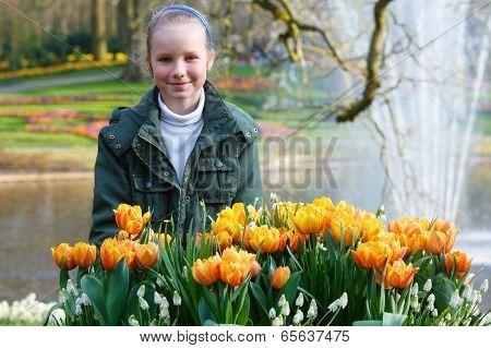 Happy Girl With Yellow Tulips.