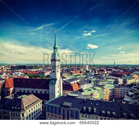 Vintage retro effect filtered hipster style travel image of aerial view of Munich and St. Peter Church  - Marienplatz and Altes Rathaus, Bavaria, Germany