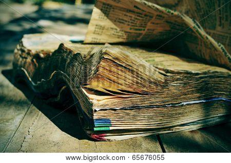 closeup of a weathered phone book