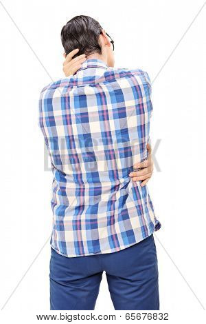Young man pretending to be kissing someone isolated on white background, rear view