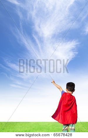 Happy Little Boy Wore Superhero Suit And Point To Sky