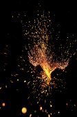 explosive shower of sparks from a welder worker on a wroght iron decorative rail poster