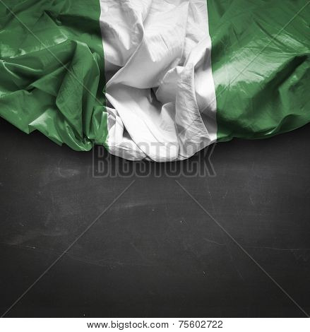 Nigeria waving flag on blackboard