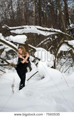 Fashion Model  In Winter Wood
