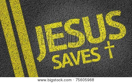 Jesus Saves written on the road