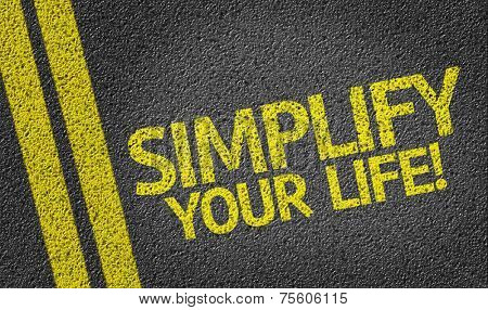 Simplify Your Life! written on the road