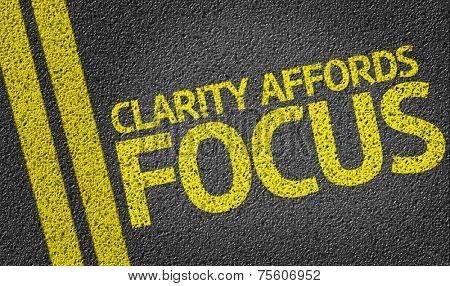 Clarity Affords Focus written on the road