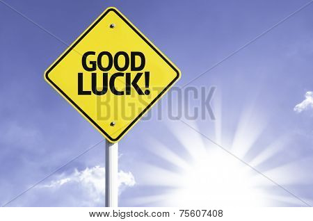 Good Luck road sign with sun background