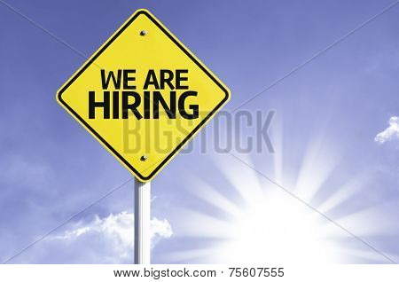 We are Hiring road sign with sun background