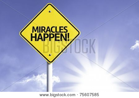 Miracles Happen road sign with sun background