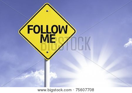 Follow Me road sign with sun background