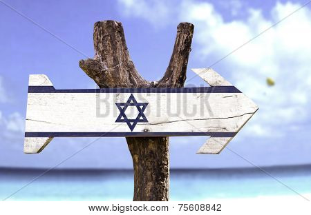 Israel wooden sign with a beach on background