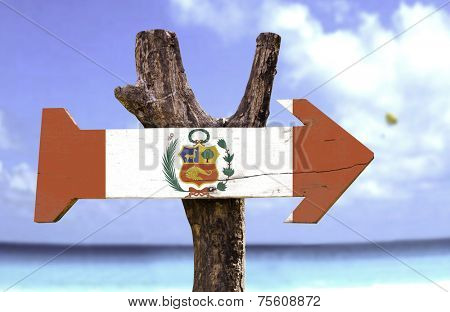 Peru wooden sign with a beach on background