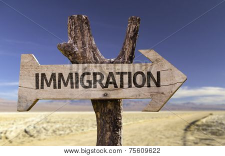 Immigration wooden sign with a desert background