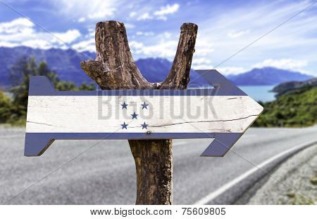 Honduras wooden sign with a island background