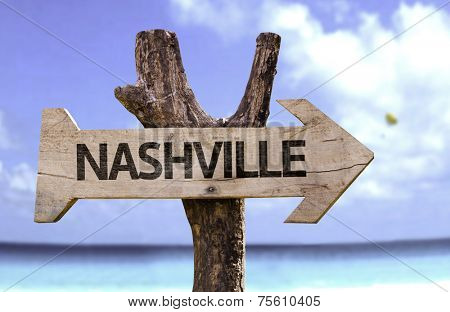 Nashville wooden sign with a river on background
