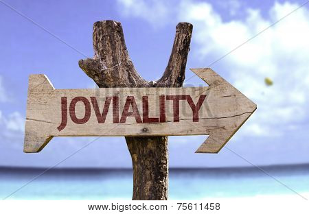 Joviality sign with a beach on background