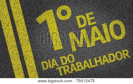 1 de Maio, Dia do Trabalhador (In Portuguese: 1 May, Labor Day) written on the road