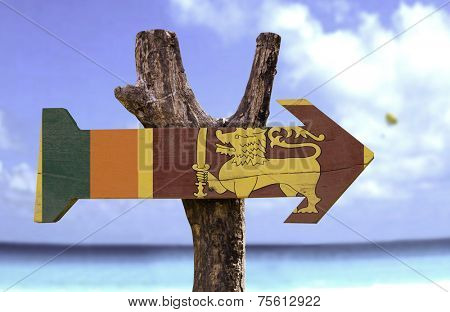 Sri Lanka wooden sign with a beach on background