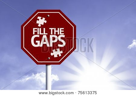 Fill the Gaps red sign with sun background