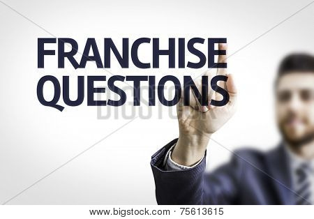 Business man pointing to transparent board with text: Franchise Questions