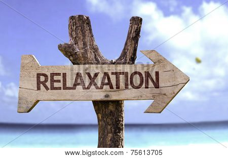 Relaxation wooden sign with a beach on background