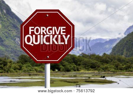 Forgive Quickly red sign with a landscape background