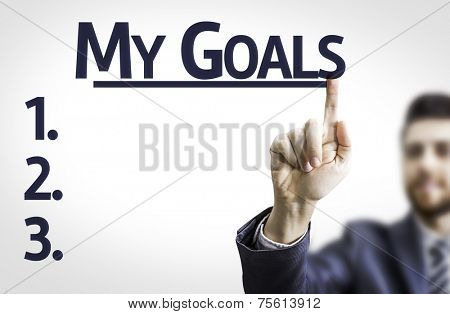 Business man pointing to transparent board with text: My Goals