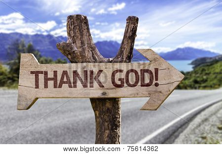 Thanks God wooden sign with a landscape background
