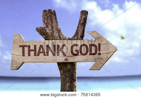 Thank God wooden sign with a beach on background