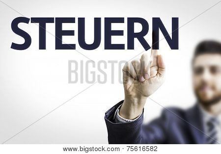 Business man pointing to transparent board with text: Steuern (German Tax)