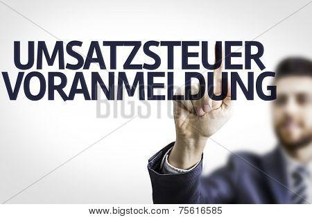 Business man pointing to transparent board with text: Umsatzsteuer Voranmeldung (German Tax)
