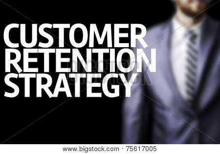 Customer Retention Strategy written on a board with a business man on background