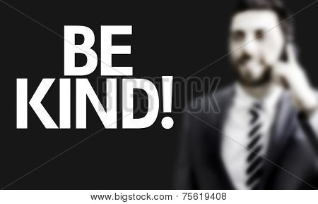 Business man with the text Be Kind in a concept image