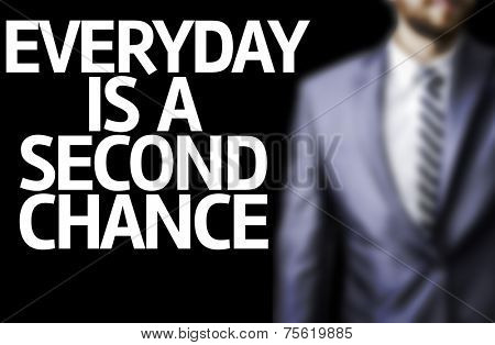 Business man with the text Everyday is a Second Chance in a concept image
