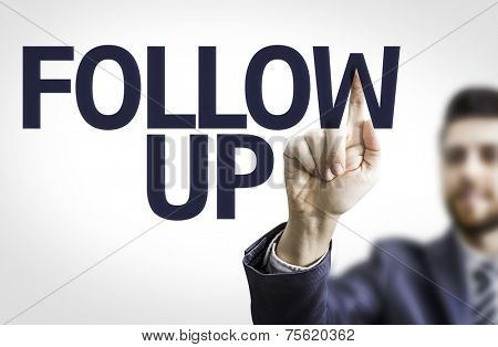 Business man pointing to transparent board with text: Follow Up
