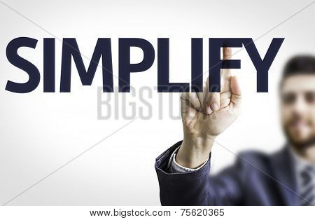 Business man pointing to transparent board with text: Simplify