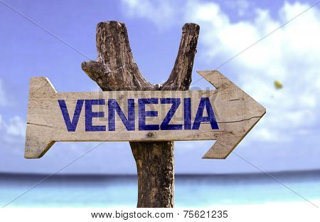 Venice (In Italian) wooden sign with a beach on background