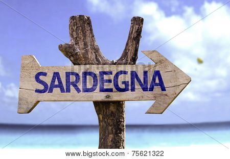 Sardinia (In Italian) wooden sign with a beach on background