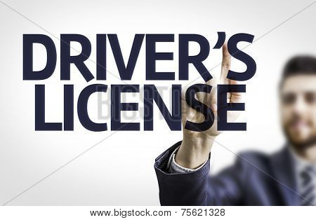 Business man pointing to transparent board with text: Drivers License