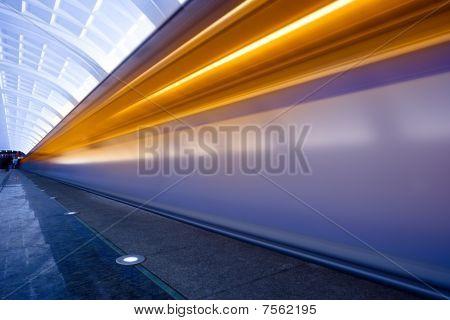 Move trains with orange lights on underground platform poster