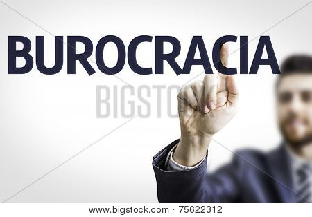 Business man pointing to transparent board with text: Bureaucracy