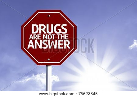 Drugs Are Not The Answer  written on red road sign with a sky on background