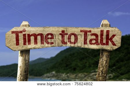 Time to Talk wooden sign with a beach on background