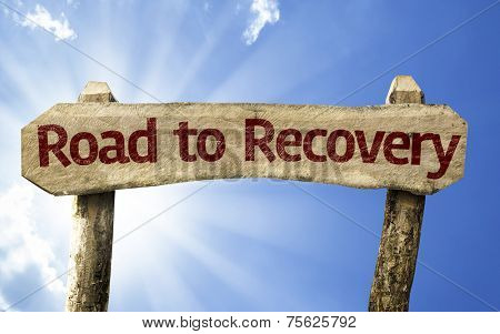 Road to Recovery wooden sign on a summer day