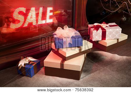 New Year's sale of gifts in shop, boxes packed by tapes and bows