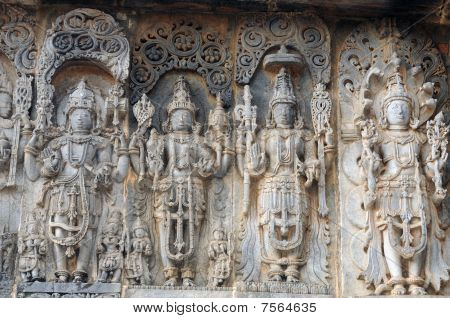 Ancient sculptures in ruins at an indian temple poster